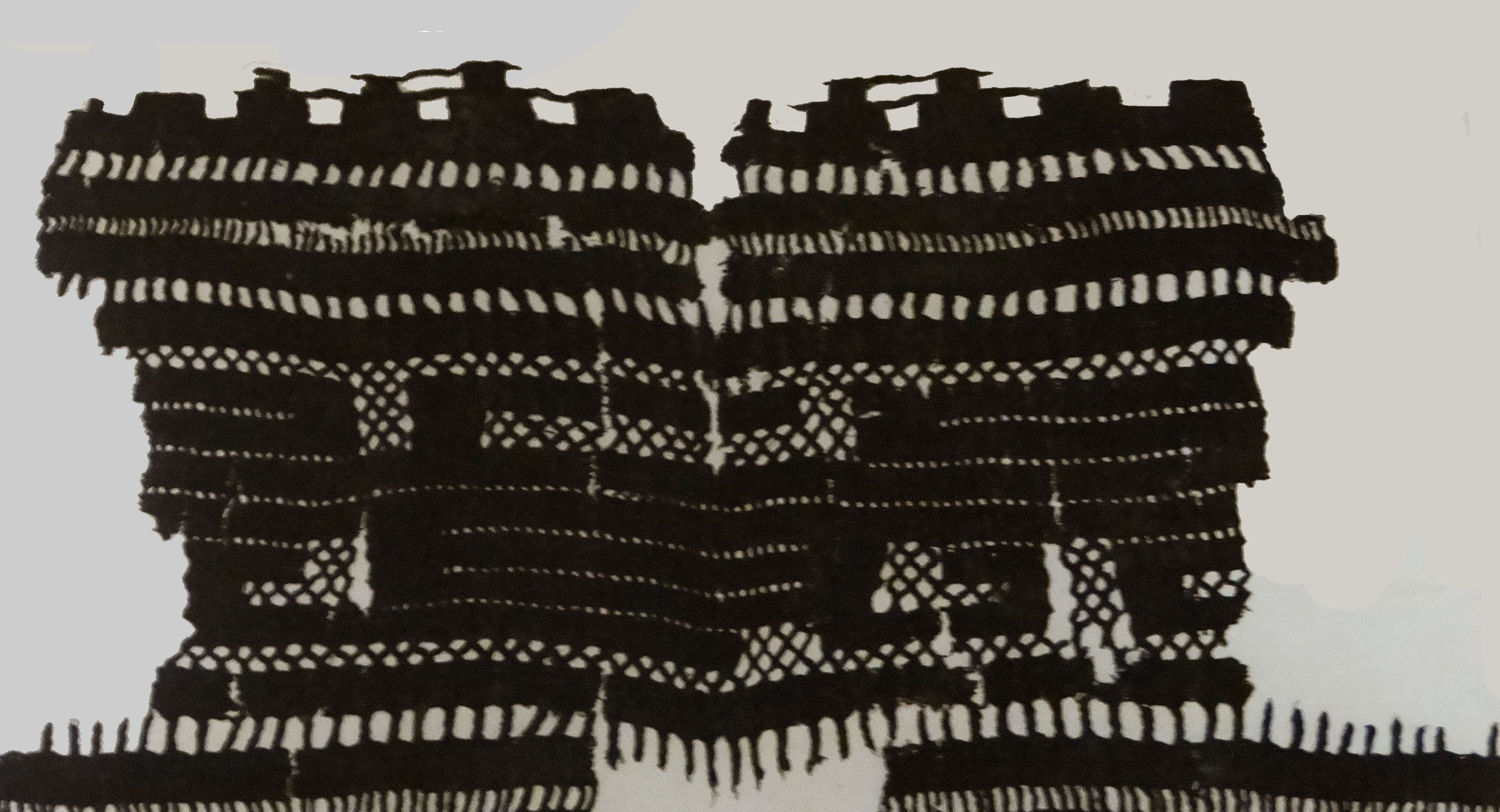Textil Carbonizado que se encontró en Chichen Itzá. Actualmente se encuentra en el Centro INAH por restauración